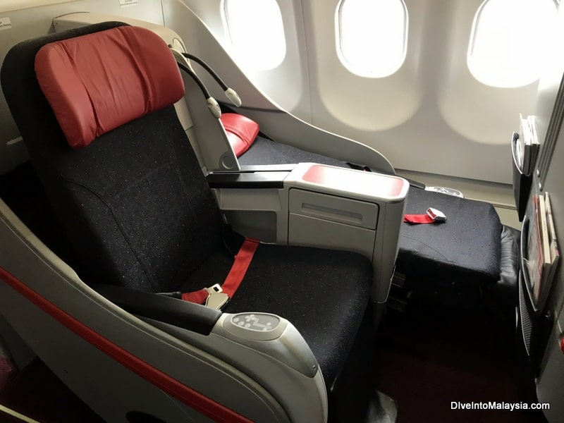 One seat fully reclined, one upright on AirAsia business class
