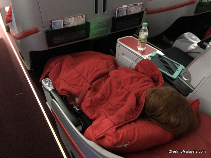 Sleeping on fully reclined AirAsia premium flatbed