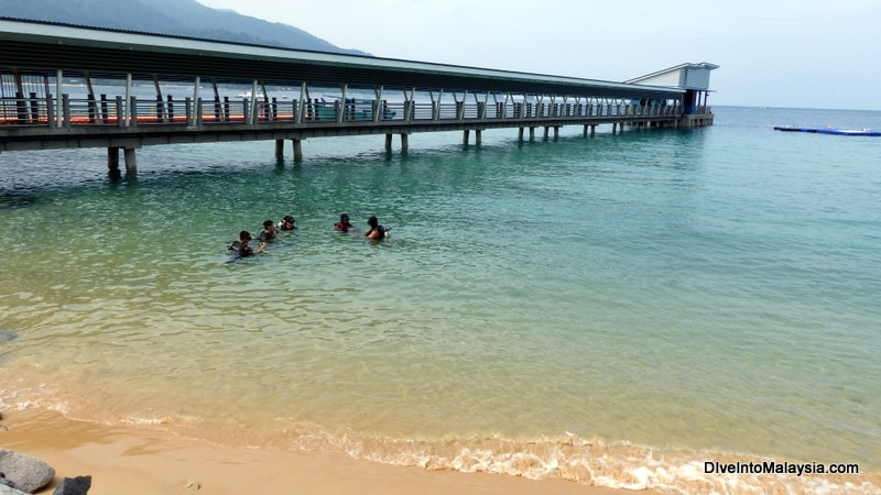 Diving class at northern end of Tekek Beach