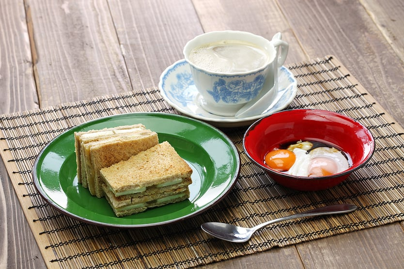 kaya jam toast with a cup of white coffee